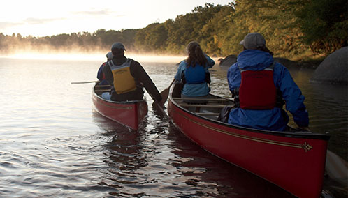 A group of Outdoor Discovery School participants on a canoe tour in L.L.Bean canoes.