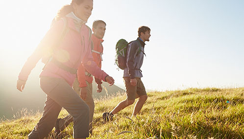 A group of hikers climbing to a summit outfitted in L.L.Bean footwear, apparel and backpacks.