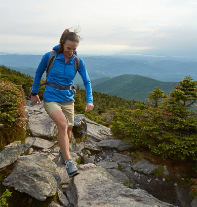 Woman hiking in the mountains wearing L.L.Bean active clothing.