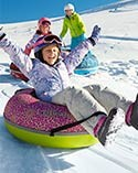 Child sledding on Sonic Snow Tube.