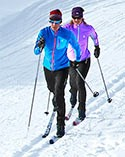 Couple cross-country skiing.