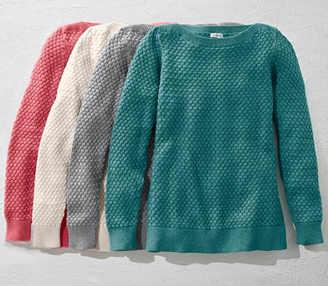 Colorful selection of beautifully textured sweaters.