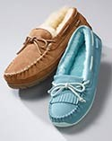Two moccasin-style slippers