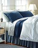 Seashell Percale Comforter Cover and matching pillowcases on bed.