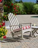 Adirondack chair with striped cushion on patio.