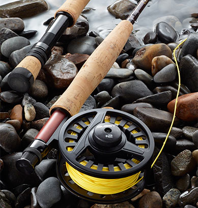 Rod and Reel on Rocks.