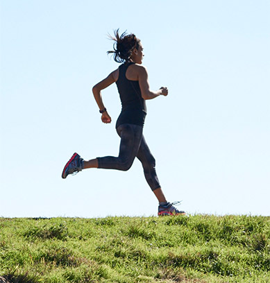 Woman in Activewear Running.