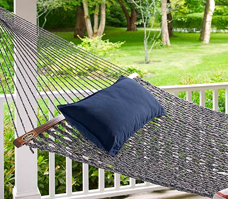 Hammock hanging on a porch.