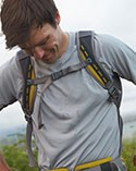 Man in a hiking backpack and active t-shirt.