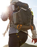 Man hiking in a Day Trekker Backpack.