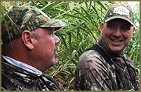 Bill and Shawn Gorman share a laugh while duck hunting in Texas.