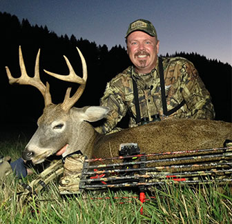 Bill in Oregon with his first Columbia whitetail with a bow.