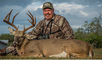 Bill with a whitetail that he harvested at the Floyd Ranch in Texas.