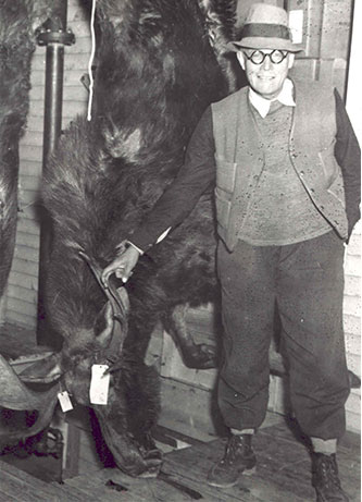 Leon Leonwood Bean with a moose that he harvested in the fall of 1935.