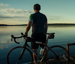 A cyclist enjoys the reward of a breathtaking view.